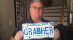 "Lorne Grabher poses with his ""Grabher"" licence plate. (CTV Atlantic)"