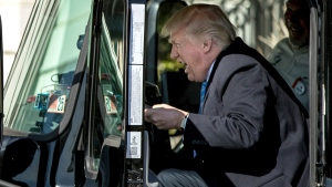 U.S. President Donald Trump pretends to drive an 18-wheeler as he meets with truckers and industry CEOs regarding healthcare, Thursday, March 23, 2017, on the South Lawn of the White House in Washington. (AP Photo/Andrew Harnik)