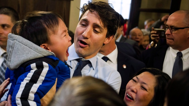 Prime Minister Justin Trudeau joins Mary Ng, right, to greet residents of the Mon Sheong Court Senior Home in Markham, Ont., Thursday, March 23, 2017. (Christopher Katsarov / THE CANADIAN PRESS)