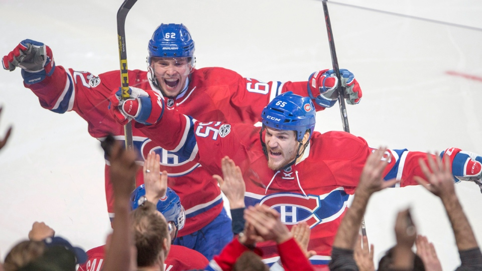 Alex Galchenyuk celebrates with Andrew Shaw and Artturi Lehkonen after scoring the first goal against the Carolina Hurricanes in Montreal on Thursday, March 23, 2017. THE CANADIAN PRESS/Ryan Remiorz