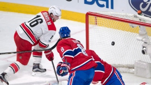 Carolina Hurricanes centre Elias Lindholm (16) scores the first goal on Montreal Canadiens goalie Carey Price (31) as Montreal Canadiens defenceman Jordie Benn (8) looks on during first period NHL hockey action in Montreal on Thursday, March 23, 2017. THE CANADIAN PRESS/Ryan Remiorz