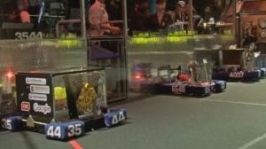 Robots compete to move balls in a competition at Claude Robillard Arena on March 23, 2017