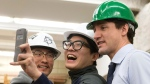 Canadian Prime Minister Justin Trudeau poses for a selfie with students during a visit to the Angelo DelZotto School of Construction Management at George Brown College in Toronto on Thursday, March 23, 2017. THE CANADIAN PRESS/Chris Young