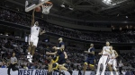 Gonzaga guard Jordan Mathews, top left, drives to the basket against West Virginia during the first half of an NCAA Tournament college basketball regional semifinal game in San Jose, Calif. on Thursday, March 23, 2017. (AP / Tony Avelar)