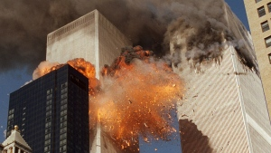 Smoke billows from one of the towers of the World Trade Center and flames as debris explodes from the second tower in New York on Sept. 11, 2001. (AP / Chao Soi Cheong)