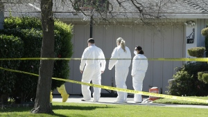 Investigators walk to the home where four people were found dead in Sacramento, Calif. on Thursday, March 23, 2017. (AP / Rich Pedroncelli)