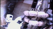 Astronauts on the ISS conduct a spacewalk