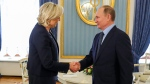 Russian President Vladimir Putin, right, shakes hands with French far-right presidential candidate Marine Le Pen, in the Kremlin in Moscow, Russia, on March 24, 2017. (Mikhail Klimentyev, Sputnik, Kremlin Pool Photo via AP)