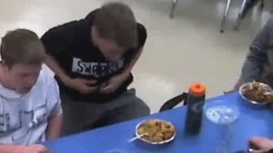 Will Olson is seen choking in this image from video. (source: Facebook / School District of La Crosse)