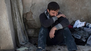 Ahmed Pesher cries next to the destroyed houses where he says 23 members of his family were killed during fights between Iraq security forces and Islamic State on the western side of Mosul, Iraq, Friday, March 24, 2017. (AP Photo/Felipe Dana)