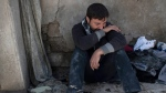 Ahmed Pesher cries next to the destroyed houses where he says 23 members of his family were killed during fights between Iraq security forces and Islamic State on the western side of Mosul, Iraq on Friday, March 24, 2017. (AP / Felipe Dana)