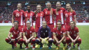 Canada's women's soccer team poses for a photo prior to first half international friendly soccer action against Mexico at B.C. Place, in Vancouver on Saturday, Feb. 4, 2017. (THE CANADIAN PRESS/Jonathan Hayward)