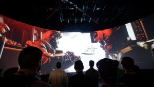 "FILE - In this June 12, 2014 file photo, people watch the ""Call of Duty: Advanced Warfare"" video game trailer at the Activision booth at the Electronic Entertainment Expo, in Los Angeles. (AP Photo/Jae C. Hong, File)"