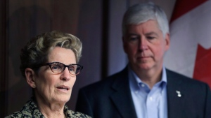 Ontario Premier Kathleen Wynne and Michigan Gov. Rick Snyder address the media Monday, March 13, 2017, in Detroit. (AP Photo/Carlos Osorio)