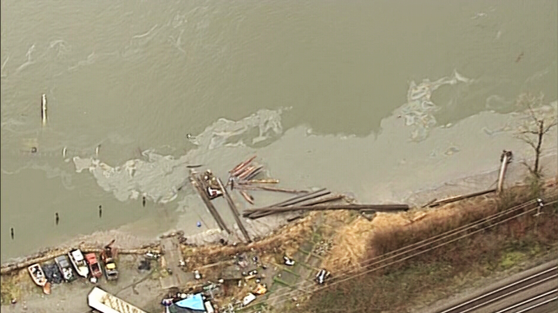 Crews from Transport Canada and the Coast Guard are investigating a sheen of unconfirmed size on the Fraser River. March 24, 2017. (CTV/Chopper 9)