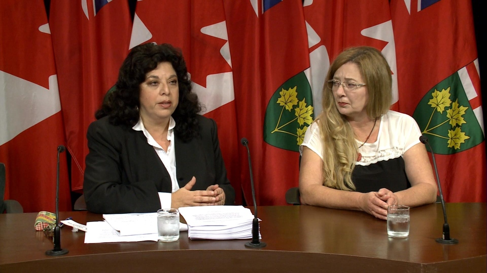 Amani Oakley (left) and Lori Dekervor announce the class action during a news conference at Queen's Park in Toronto on October 20, 2016.