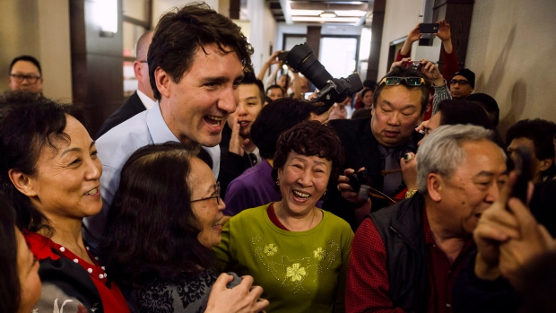 Prime Minister Justin Trudeau greets residents of the Mon Sheong Court Senior Home in Markham, Ont., on Thursday, March 23, 2017. (THE CANADIAN PRESS/Christopher Katsarov)