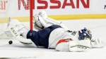 Florida Panthers goalie Roberto Luongo dives for the puck in Nashville, Tenn., on Feb. 11, 2017. (Mark Humphrey / AP)