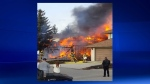 Calgary Fire Department members battle a massive fire at a home on Sunvista Way SE (image courtesy: Don Thorssen)