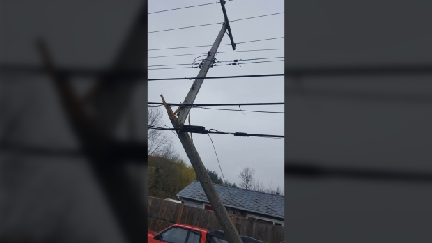 Two women were rushed to hospital with minor injuries in a crash that snapped a power pole and shut down Sooke Road for hours Friday, March 24. (Photo courtesy Victoria Buzz)