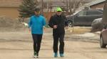 David Wood, left, is seen running in Winnipeg, Manitoba.