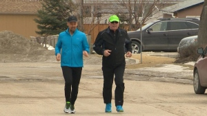 David Wood, left, is seen running in Winnipeg, Manitoba.