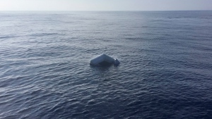 In this photo released by Proactiva Open Arms NGO on Friday, March 24, 2017 an upturned rubber boat floats in the Mediterranean Sea off the Libyan coast, during a search and rescue operation by Spanish NGO Proactiva Open Arms. (Proactiva Open Arms via AP)