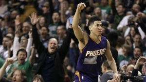 Phoenix Suns guard Devin Booker gestures after he scored a basket, as fans cheer him at TD Garden in the fourth quarter of the Suns' NBA basketball game against the Boston Celtics, Friday, March 24, 2017, in Boston. (AP / Elise Amendola)