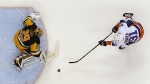 New York Islanders' John Tavares (91) fires the game-winning shot past Pittsburgh Penguins goalie Marc-Andre Fleury (29) in the shootout of an NHL hockey game in Pittsburgh, Friday, March 24, 2017. (AP / Gene J. Puskar)