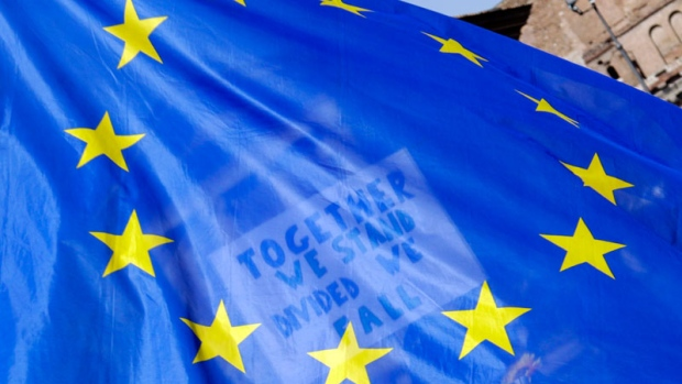 A placard in support of the European Union is seen through an European flag as demonstrators prepare to take part into a demonstration in support of the European Union in Rome, Saturday, March 25, 2017, the day leaders of the European Union gathered in Rome to mark the 60th anniversary of the bloc. (AP /Gregorio Borgia)