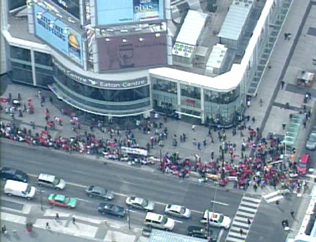 Thousands of Toronto Tamils lined up outside the Eaton Centre to protest the civil war in Sri Lanka. The local Tamils are planning on forming a human chain through the city's core.