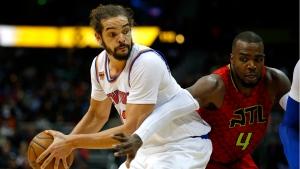 New York Knicks center Joakim Noah (13) looks to pass as Atlanta Hawks forward Paul Millsap (4) is defending in the first overtime of an NBA basketball game on Sunday, Jan. 29, 2017, in Atlanta. (AP Photo/Todd Kirkland)