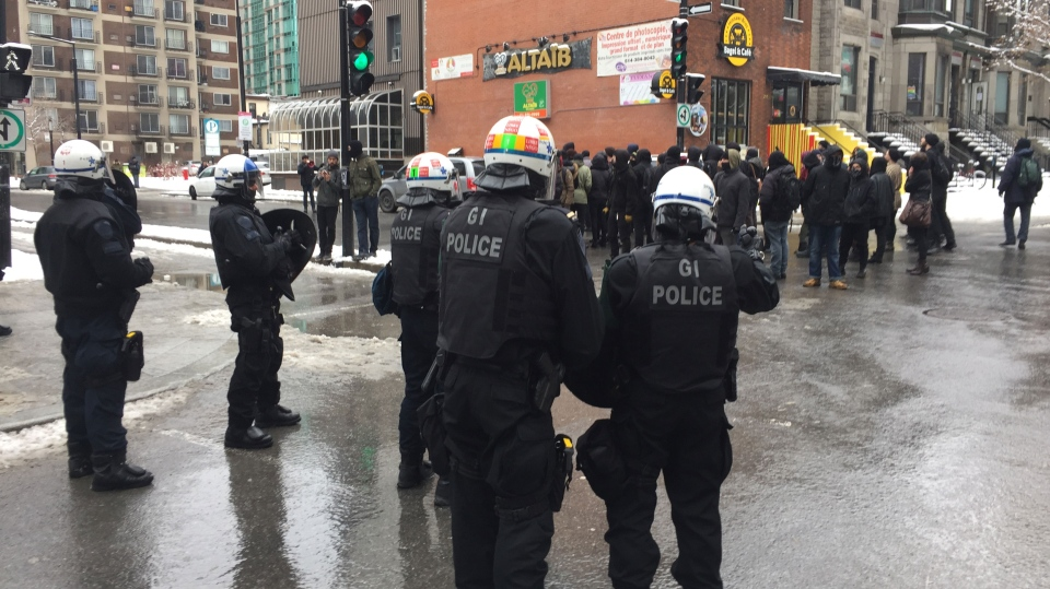 Riot police were on hand as right-wing and left-wing groups both protested in front of Concordia on Saturday. (Photo: CTV Montreal)