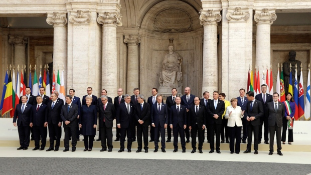 European Union heads of state pose for a group photo in the Cortile di Michelangelo during an EU summit in Rome on Saturday, March 25, 2017. EU leaders were gathering in Rome to mark the 60th anniversary of their founding treaty and chart a way ahead following the decision of Britain to leave the 28-nation bloc. (AP Photo/Andrew Medichini)