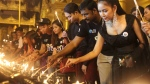 Volunteers light oil lamps during earth hour celebrations at Myanmar's famous Shwedagon pagoda Saturday, March 25, 2017, in Yangon, Myanmar. Volunteers took part in earth hour celebrations organised by World Wide Fund for Nature (WWF-Myanmar) for the first time in the country. Earth Hour takes place worldwide and is a global call to turn off lights for 60 minutes in a bid to highlight the global climate change. (AP Photo/Thein Zaw)
