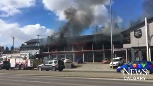 Flames and smoke pour from Union Square, in the 4500 block of Macleod Trail, early Saturday afternoon (image courtesy: Kyle Sta. Maria)
