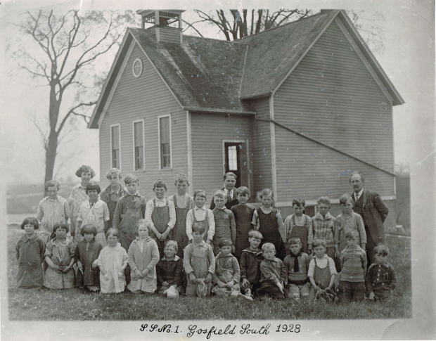 The Gosfield South one-room schoolhouse, as seen with its 1928 class, is being restored at its current location in the Canadian Transportation Museum and Heritage Village in Kingsville. (courtesy: Canadian Transportation Museum and Heritage Village)
