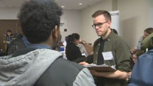 More than 1,000 people lined up for the Outlet Collection Winnipeg job fair at the Delta Hotel on Saturday.