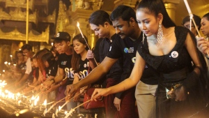 Volunteers light oil lamps during earth hour celebrations at the famous Shwedagon pagoda, in Yangon, Myanmar, on Saturday, March 25, 2017. (AP Photo/Thein Zaw)