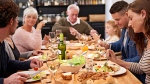 People enjoy a meal in this undated stock photograph. (PeopleImages/Istock.com)