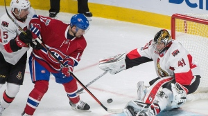 Montreal Canadiens' Tomas Plekanec (14) moves in on Ottawa Senators goalie Craig Anderson as the Senators' Cody Ceci (5) defends during second period NHL hockey action in Montreal, Saturday, March 25, 2017. THE CANADIAN PRESS/Graham Hughes