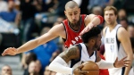 Dallas Mavericks guard Wesley Matthews, front, battles Toronto Raptors forward Jonas Valanciunas, top, for space during the first half of an NBA basketball game Saturday, March 25, 2017, in Dallas. (AP Photo/Brandon Wade)