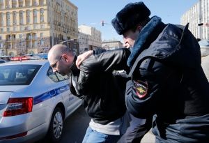 Police officer detains a protester in downtown Moscow, Russia, Sunday, March 26, 2017. (AP / Alexander Zemlianichenko)