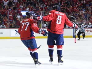 Washington Capitals left wing Alex Ovechkin (8) celebrates his goal with right wing T.J. Oshie (77) during the first period of the team's NHL hockey game against the Arizona Coyotes, Saturday, March 25, 2017, in Washington. (AP / Molly Riley)