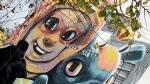 A man walks past a street art mural on the facade of a house in Fanzara near Castellon de la Plana. (Jose Jordan / AFP)