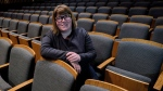 Vicki Stroich, Alberta Theatre Projects executive director, sits in an empty theatre in Calgary, Alta., Thursday, March 16, 2017. (Jeff McIntosh / THE CANADIAN PRESS)