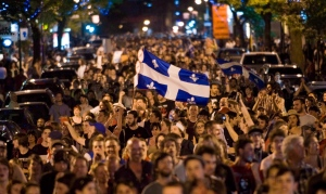 Protesters opposing Quebec student tuition fee hikes demonstrate in Montreal, May 20, 2012. (Graham Hughes / THE CANADIAN PRESS)