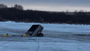 Warman fire crews respond to a vehicle in the ice at Clarkboro Ferry (Twitter: Warman Fire Rescue)