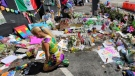 FILE - In a Monday, July 11, 2016 file photo, visitors continue to flock to the Pulse nightclub to their pay their respects, in Orlando, Fla. (Joe Burbank/Orlando Sentinel via AP, File)