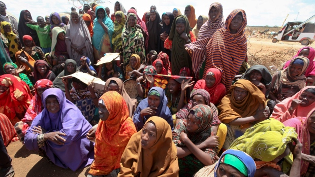 In this photo taken Saturday, March 25, 2017, newly displaced Somali women gather near to their makeshift shelters at a camp in Baidoa, Somalia. (AP Photo/Farah Abdi Warsameh)